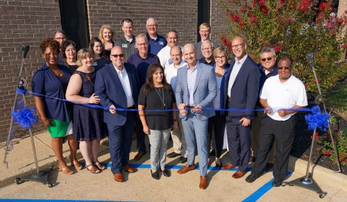 Mark Jobe cutting Ribbon at Moody Radio Chattanooga